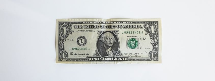Dollar bill against white background