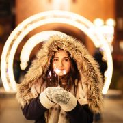 woman holding sparkler for stocks