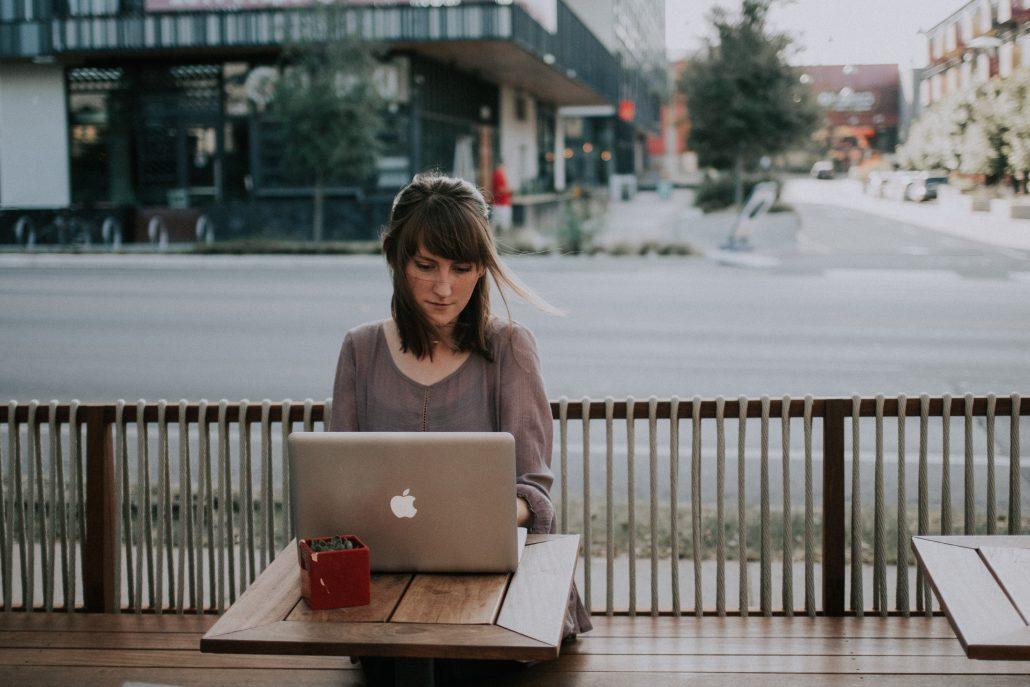 woman on laptop on patio