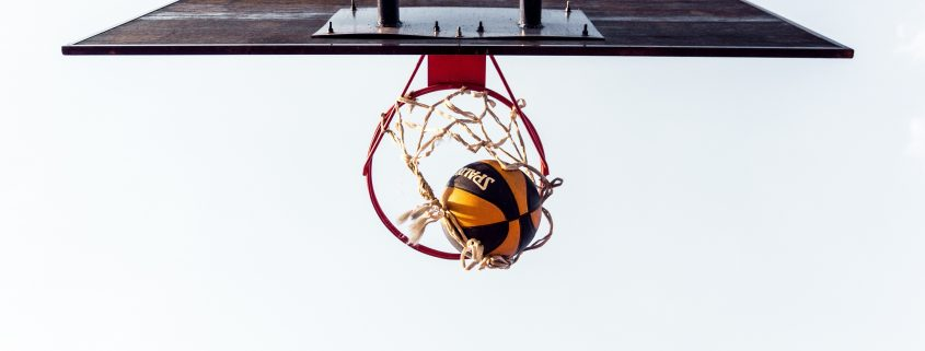basketball court with ball in hoop