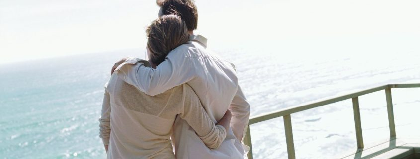 Couple overlooking ocean on boat
