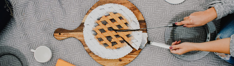 cutting into a pie