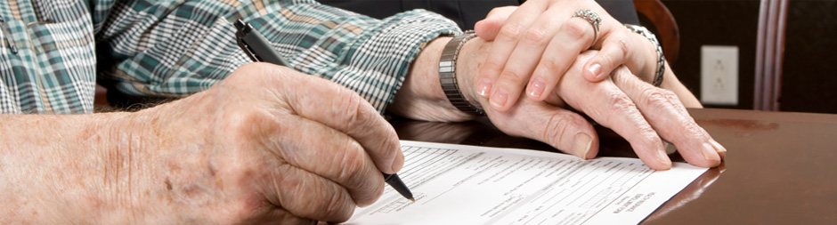 Hands writing a document