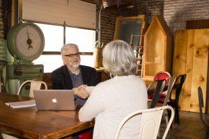 Gordon Fischer meeting with client