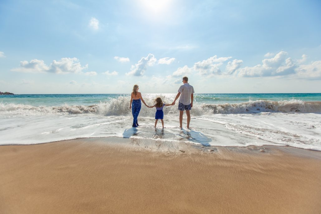 couple with child at beach