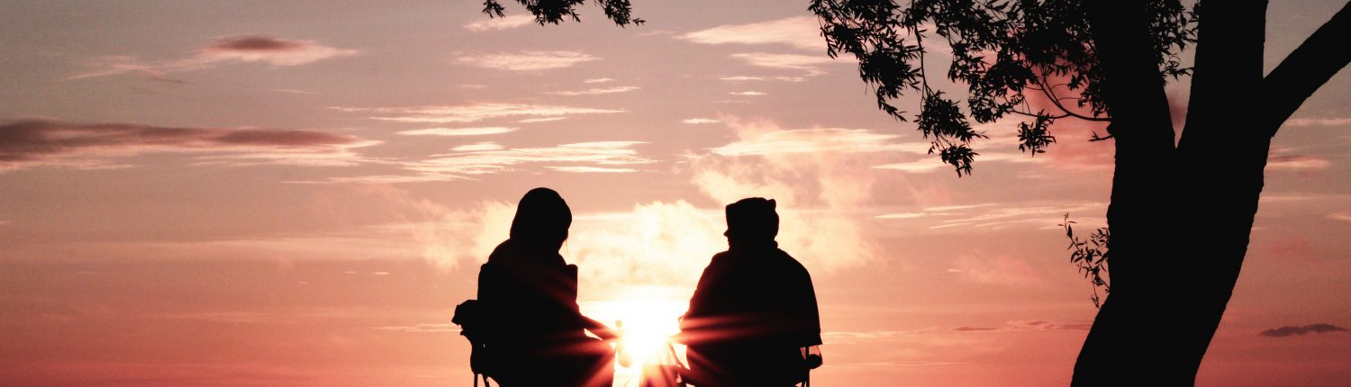 Two people looking at sunset