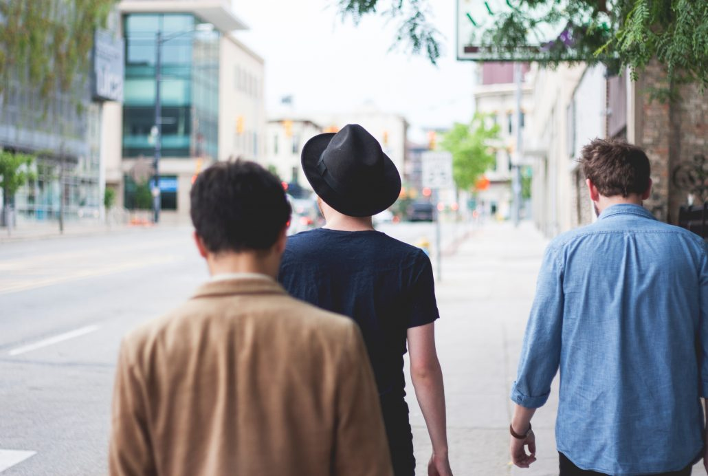 Three men walking down the street