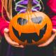 Girl holding scary pumpkin