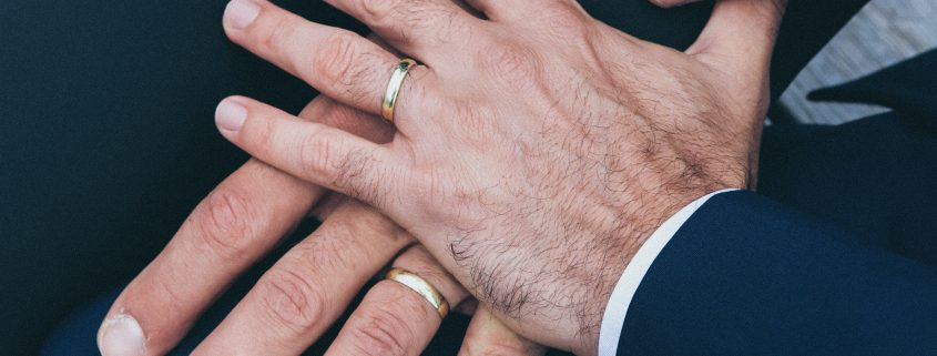 hands of 2 grooms