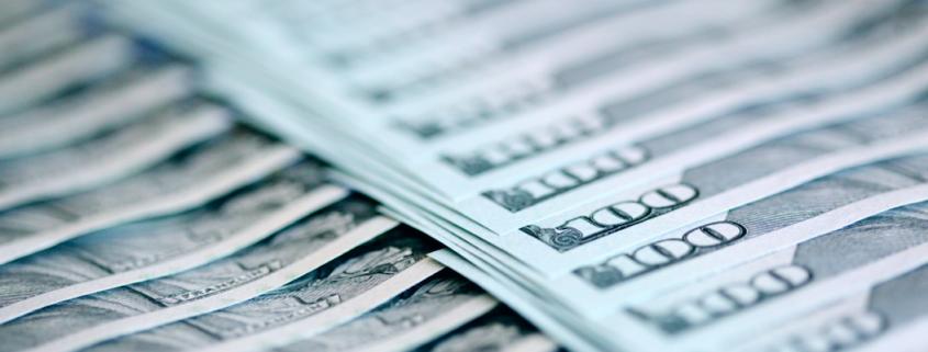 Rows of 100 dollar bills