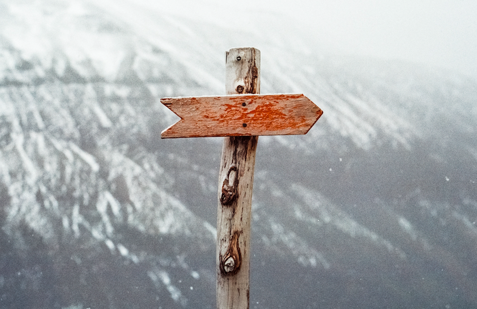 direction sign on a mountain
