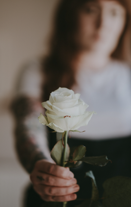 woman giving white rose