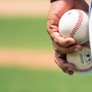 pitcher holding baseballs