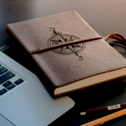 compass journal near macbook