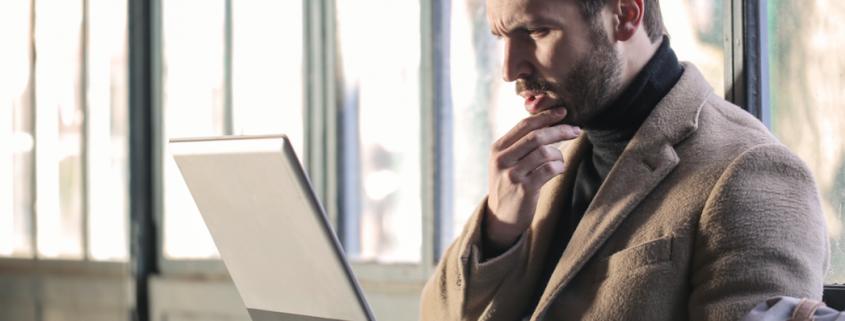 man questioning computer