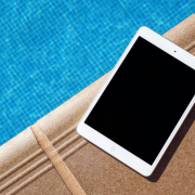 july newsletter tablet by pool