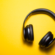 black headphones against yellow background